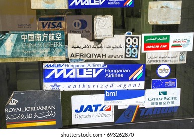 CAIRO, EGYPT - JANUARY 30, 2010: Airline logos through the window of travel agency including non existing Yugoslav Airlines (JAT) in downtown Cairo