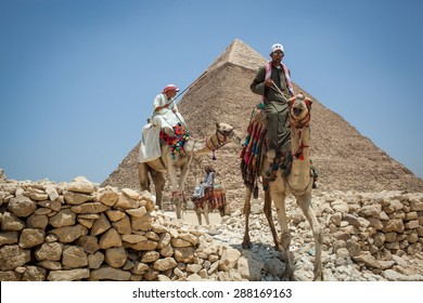 Cairo, Egypt - July 17, 2013: Camel guides wait for tourists at the pyramids .