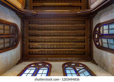 Cairo, Egypt - July 28 2018: Decorated ceiling with floral pattern decorations and stained glass windows at Sultan al Ghuri Mausoleum
