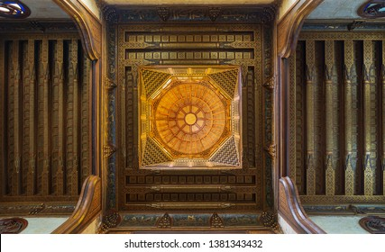Cairo, Egypt- July 28 2018: Wooden decorated dome mediating ornate wooden ceiling with floral pattern decorations at Sultan al Ghuri Mausoleum