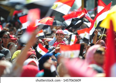 Cairo, Egypt - July 3, 2013 Egyptians celebrate Tahrir Square with the departure of the deposed president Mohamed Morsi , which was carried out by the Egyptian army .