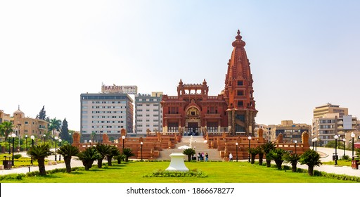 Cairo, Egypt- July 30 2020: Facade of Baron Empain Palace, a historic mansion inspired by the Cambodian Hindu temple of Angkor Wat, with Baron Hotel in the far end, located in Heliopolis district