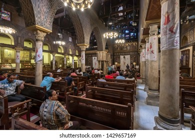 CAIRO, EGYPT - JUNE 10, 2019: The  interior of The Hanging Church (Saint Virgin Mary's Coptic Orthodox Church) with group of tourists