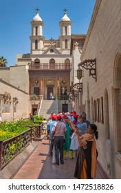 CAIRO, EGYPT - JUNE 10, 2019:  The Hanging Church (Saint Virgin Mary's Coptic Orthodox Church) with group of tourists