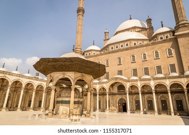 CAIRO, EGYPT - JUNE 8, 2014: The courtyard of the Great Mosque of Muhammad Ali Pasha. Prayers and tourists in the mosque