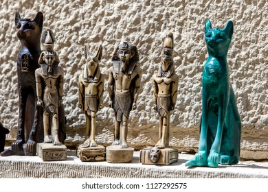 CAIRO, EGYPT - MARCH 11, 2010 : Tourist souvenirs including miniture statues for sale near the Sphinx on the Giza Plateau in Cairo in Egypt.