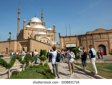 CAIRO, EGYPT - MARCH 13, 2010 : Tourists take photos of the magnificent Cairo Citadel (Citadel of Salah Al-Din) in Cairo, Egypt. It is a medieval Islamic fortification on Mokattam Hill.