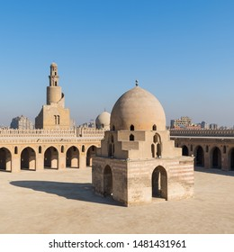 Cairo, Egypt- March 14 2015: Courtyard of Ibn Tulun public historical mosque with ablution fountain and the minaret, Sayyida Zaynab district, Medieval Cairo