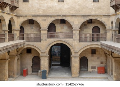 Cairo, Egypt - March 18 2017: Facade of caravansary (Wikala) of Bazaraa, with vaulted arcades and windows covered by interleaved wooden grids (mashrabiyya), suited in Tombakshia street, Al Gamalia