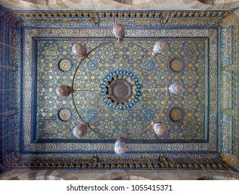 Cairo, Egypt - March 25 2018: Ornate ceiling with blue and golden floral pattern decorations at Sultan Barquq mosque, Al Moez Street, Cairo, Egypt