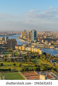 Cairo, Egypt - March 25, 2021 - Beautiful Vertical birdseye sunset view of the Nile and downtown Cairo with the cityscape seen from Cairo Tower