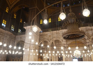 Cairo, Egypt - March 9, 2019: Interior of the Mohamed Ali mosque, located in the Saladin Citadel on the Mokkatam hill in Cairo. Beautiful chandelier and painting in the mosque.