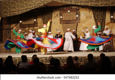 Cairo, EGYPT - May 12, 2012: Male Egyptian Sufi dancers in colorful circular sheet