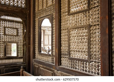 Cairo Egypt May 14 2009: Interior of El Sehemy house, an old Ottoman era house in Cairo, built in 1648, with interleaved wooden windows (Mashrabiya) and arabisk wooden couches