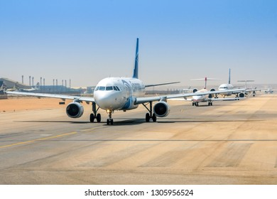 CAIRO, EGYPT - MAY 29, 2012: Airplanes are queuing for take-off from Cairo international airport during a hot summer day.