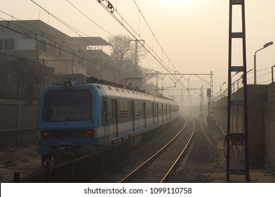 Cairo, Egypt - A Metro train arriving to the station in a misty day
