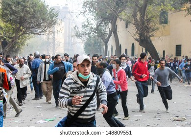 CAIRO, EGYPT - NOV 22-Thousands of protesters flocked to Cairo's Tahrir Square, Egypt, Nov 22, 2011. People were dead and injured because of tear gas, rubber bullets of riot police.