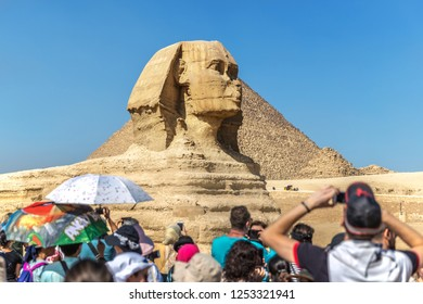 Cairo, Egypt - Nov 4th 2018 - Big group of tourist taking pictures of the Great Sphinx of Giza in a blue sky day in Egypt