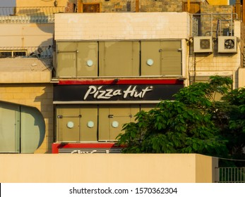 Cairo, Egypt - November 1, 2019: View of the Pizza Hut in front of the Pyramids of Giza.