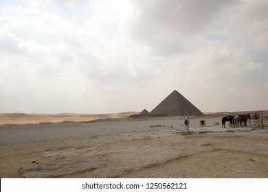 Cairo, Egypt – November 12, 2018: photo for Pyramid of munqarie in the Pyramids of Giza in Cairo city capital of Egypt.and show tourists and hourses.