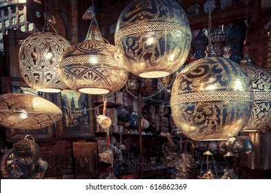CAIRO, EGYPT - NOVEMBER 16, 2016: Arabic copper lamps are sell in ancient street of Cairo. Oldest market of Khan El-Khalili Souq in old town. Traditional eastern craft-shops for tourist in Egypt.