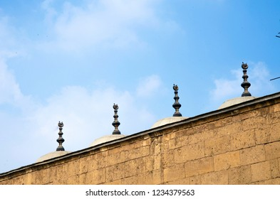 Cairo, Egypt - November 2, 2018: group of domes above Mohamed Ali Mosque in Saladin castle with clouds moving in the sky