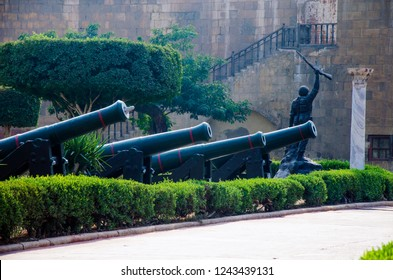 Cairo, Egypt - November 8, 2018: Cannons and statue of soldier raises his gun in the entrance of the military museum in Saladin castle