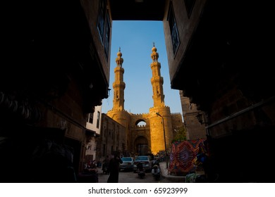 Cairo, Egypt - October 11, 2010: The Bab Zuweila Gateway, minarets and entrance to the tentmakers bazaar in old Islamic Cairo