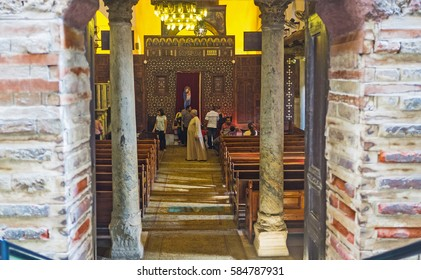 CAIRO, EGYPT - OCTOBER 12, 2014: The view on the prayer hall of Abu Sarga church from its entrance with two old columns, on October 12 in Cairo.