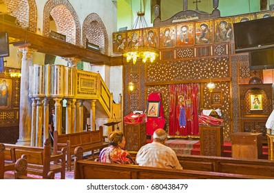 CAIRO, EGYPT - OCTOBER 12, 2014: The  prayer hall of St Barbara church with the wooden iconostsasis and the old stone amvon, on October 12 in Cairo.