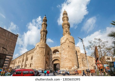 CAIRO, EGYPT - OCTOBER 12, 2018: The medieval Gates of Bab Zuweila located in heart of Islamic Cairo and surrounded by noisy arabic souq (market), on October 12 in Cairo.