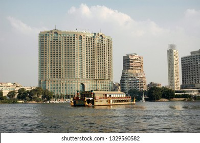 CAIRO, EGYPT - OCTOBER 20, 2008: The Four Seasons Hotel seen from the Nile River with a tour boat passing in front.