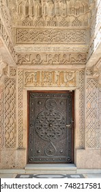 Cairo, Egypt - October 21, 2017: Closed wooden aged door with ornate bronzed floral patterns at the mosque of The Manial Palace of Prince Mohammed Ali Tewfik, Cairo, Egypt
