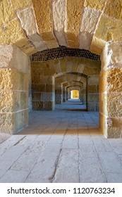 Cairo, Egypt - October 25 2012: Stoned arched Passage at Qaitbay Citadel, Alexandria, Egypt