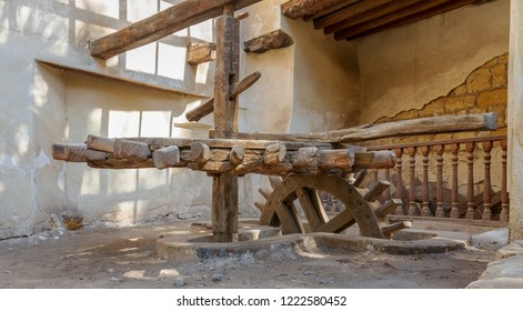 Cairo, Egypt - October 27 2018: Ancient rotary Flour Mill used to be rotated by animal power in front of El Sehemy historic house, El Moez street