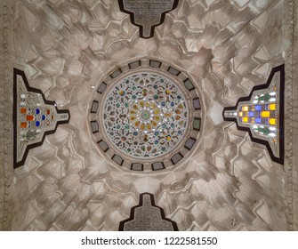 Cairo, Egypt - October 27 2018: Carved plaster dome decorated with colored glass pieces of a pergola in front of El sehemy historical house, El Moez street