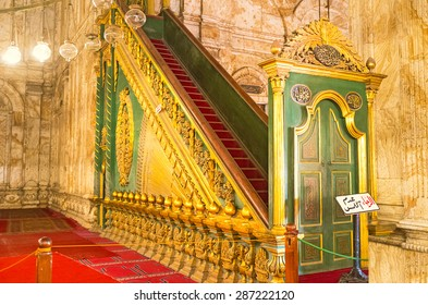 CAIRO, EGYPT - OCTOBER 9, 2014: The green wooden minbar of the Great Mosque of Muhammad Ali Pasha decorated with golden traceries, on October 9 in Cairo.