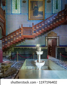 Cairo, Egypt - September 15 2018: Manial Palace of Prince Mohammed Ali. Main hall of the residence building with Turkish floral blue pattern ceramic tiles, vintage furniture and big painting
