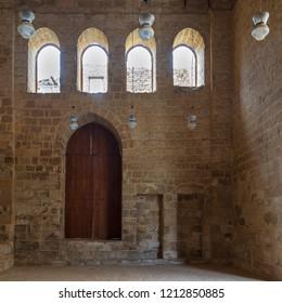 Cairo, Egypt - September 22 2018: Public Mosque attached to Al-Muayyedi Bimaristan historic building, with wooden door and bricks stone wall, Darb Al Labana district, Old Cairo