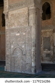 Cairo, Egypt - September 8 2018: Ornate engraved stone wall with floral patterns and calligraphy in front of the foundation stone of Ahmed Ibn Tulun Mosque, Cairo, Egypt