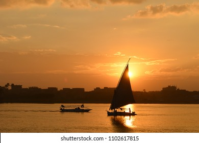 Cairo, Egypt - Sunset over Nile River with silhouettes of pleasure boats
