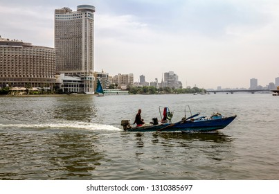Cairo. Egypt.April 13, 2014.Sailboats on the Nile in Cairo in Egypt against the backdrop of buildings