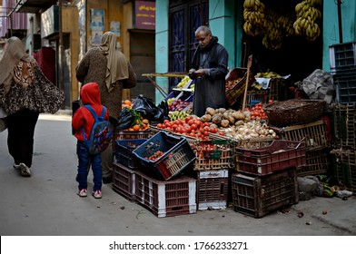 Cairo, Egyt, 5.02.2018. Market trader selling fruits and vegetables. Street market. Street seller in Cairo. An old man on the street selling vegetables.