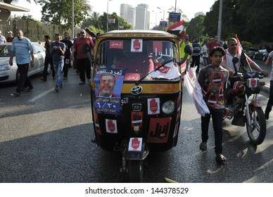CAIRO - JUNE 30: Demonstration signs and stickers against the President Morsi on a motor tricycle (Toktok) in el-Tahrir Street on June 30, 2013 in Cairo, Egypt