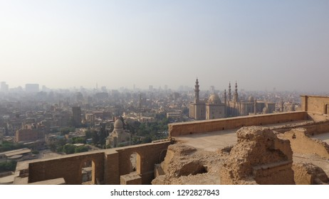 CAIRO - OCTOBER 7, 2018: The view from the outer wall of Saladin Citadel on the Islamic Cairo with hazy residential quarters, Al Rifai' and Sultan Hassan Mosques