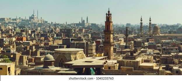 Cairo panorama with view on medieval mosques and minarets in old city maked from top.