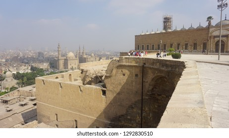 CAIRO - SEPTEMBER 27, 2018: The view from the outer wall of Saladin Citadel on the Islamic Cairo with hazy residential quarters, Al Rifai' and Sultan Hassan Mosques on sunset, Egypt.