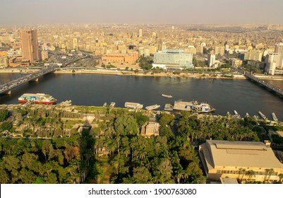 Cairo-Egypt - October 04, 2020: Beautiful city overview from Cairo Tower and car traffic during day. Panorama of Cairo cityscape with Nile river. Al Zamaler - Omar Al Khayam