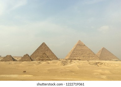 Cairo/Egypt - October 2018: View of the Pyramids of Giza, consisting of the Great Pyramid of Giza, also known as the Cheops-pyramid, the Pyramid of Khafre and the Pyramid of Menkaure in Cairo.