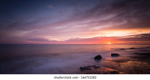 Caister beach just as the sun rose over the sea turning night into daylight on this lovely piece of Norfolk's coastline